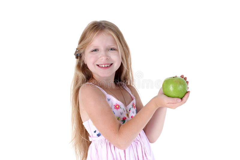 Маленькая девочка с яблоком стоковое фото