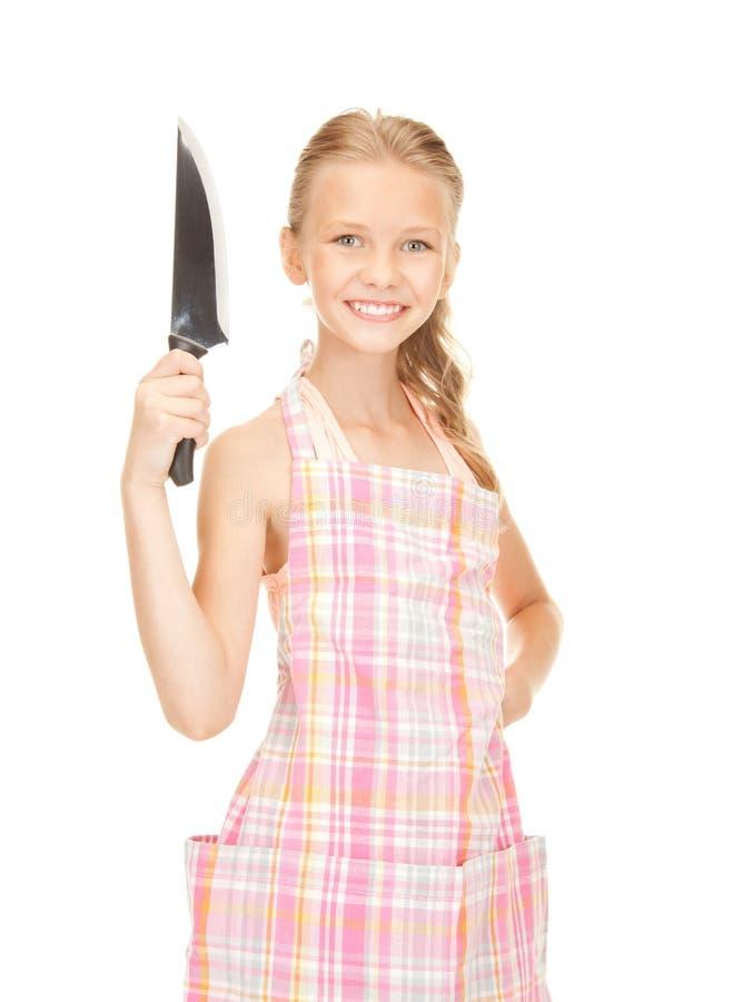 Маленькая домохозяйка с ножом стоковая фотография
