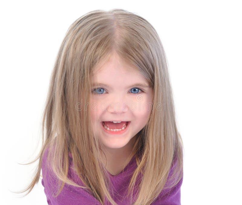 Маленькая счастливая девушка на белой предпосылке стоковое фото
