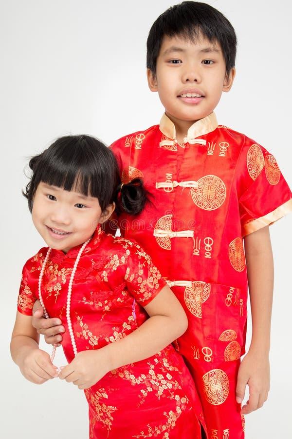 Маленький азиатский милый ребенок в костюме китайца стоковая фотография rf
