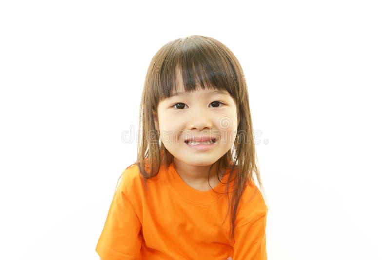 Маленький азиатский усмехаться девушки стоковая фотография rf