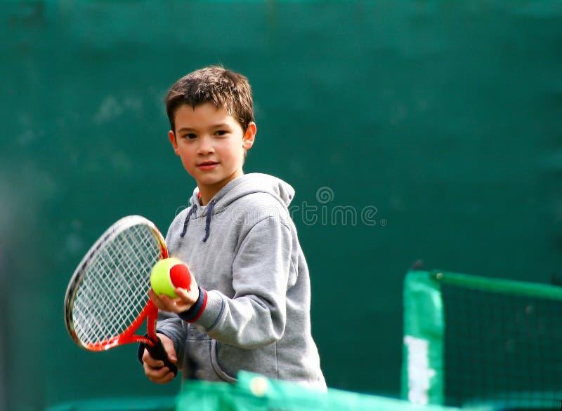 маленький теннис игрока стоковое изображение