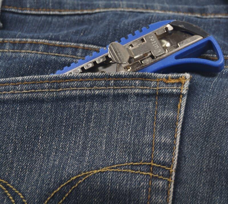 Малые нож или резец в карманн демикотона стоковое изображение