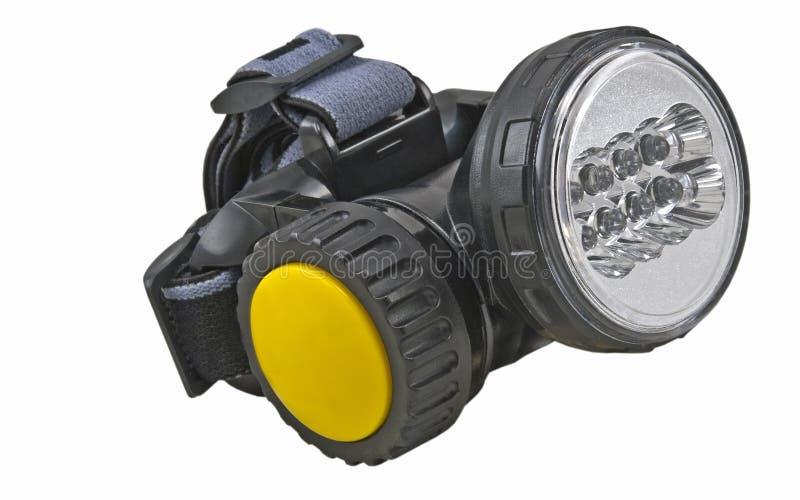 Малый голов-установленный электрофонарь на белизне стоковая фотография rf