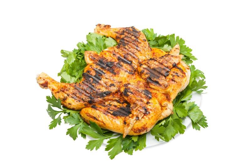 Малый зажаренный цыпленок на белом блюде стоковые изображения rf