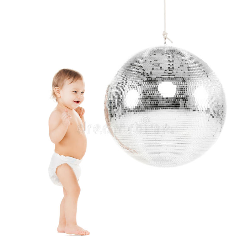 Малыш играя с шариком диско стоковые фото