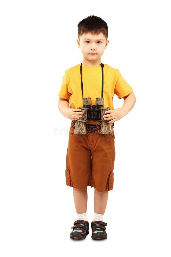Мальчик держа бинокль стоковое фото rf