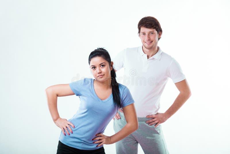 Мальчик и девушка в sportswear стоковые фотографии rf