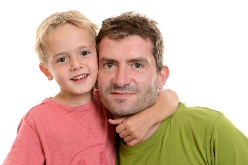 Мальчик и его папа совместно стоковые фото