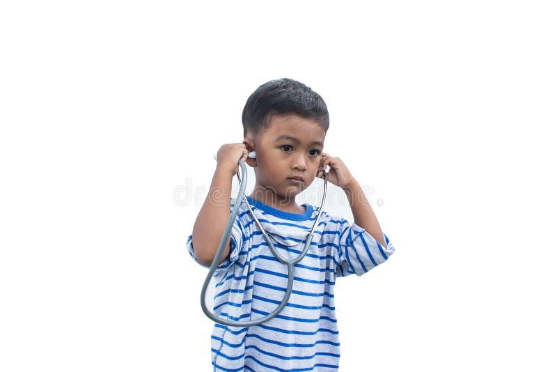 мальчик и стетоскоп стоковые изображения