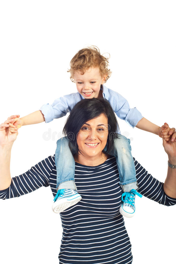 Мальчик матери и ребенк имея потеху стоковое фото rf