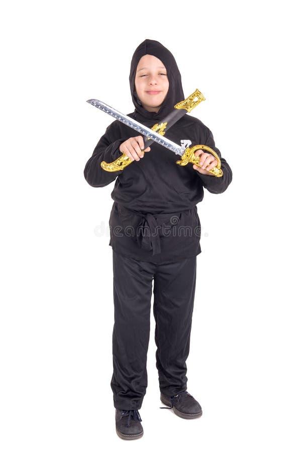 Мальчик представляя на хеллоуине стоковая фотография rf
