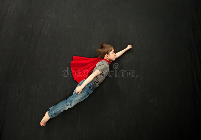 Мальчик супергероя стоковая фотография rf