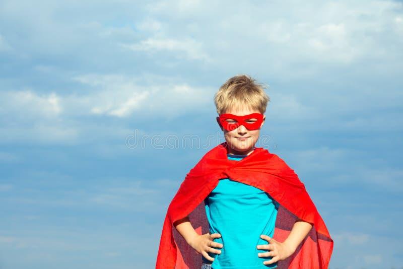 Мальчик супергероя стоковые изображения