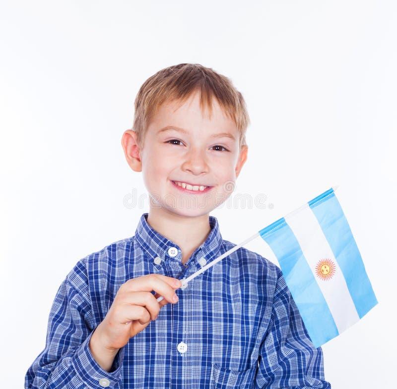 Мальчик с аргентинским флагом стоковое изображение rf