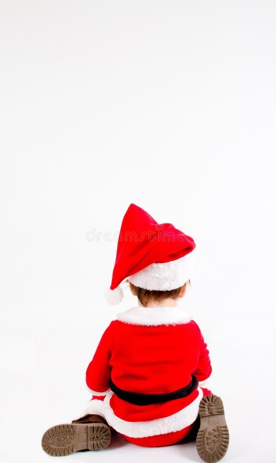Мальчик с костюмом Санты стоковая фотография rf