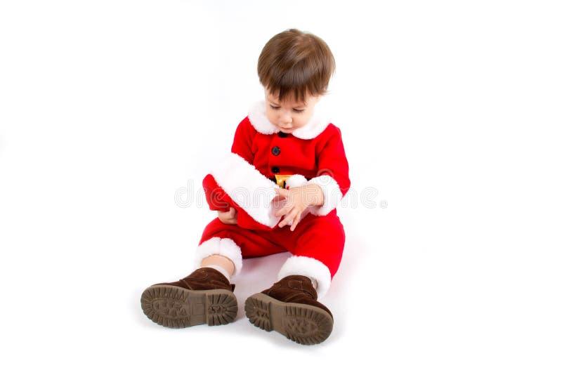 Мальчик с костюмом Санты стоковая фотография