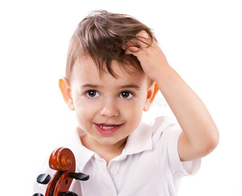 Мальчик с скрипкой стоковое фото