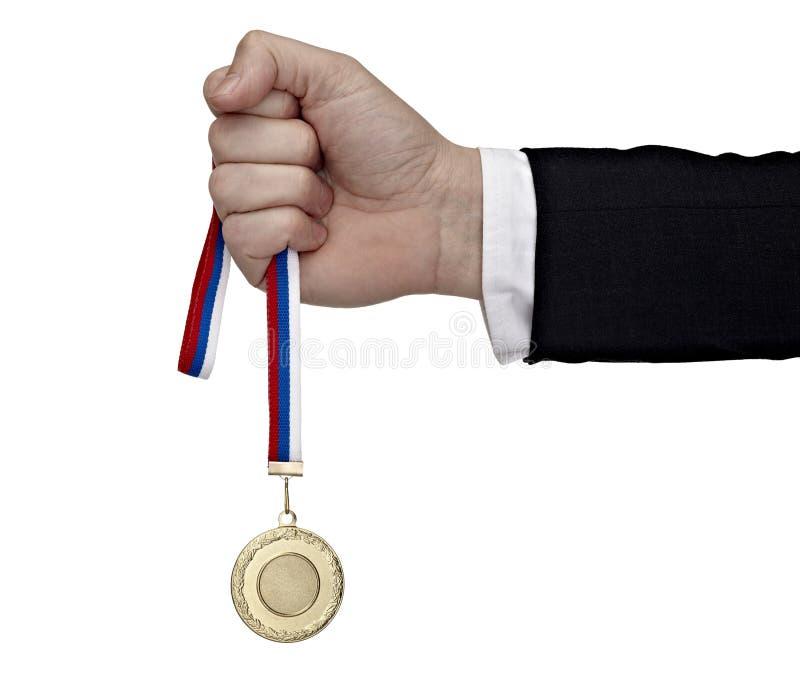 медаль удерживания руки дела золотистое стоковые изображения