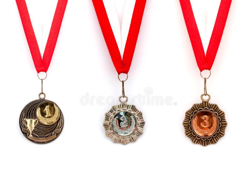 Медаль установило красную белую ленту стоковые изображения