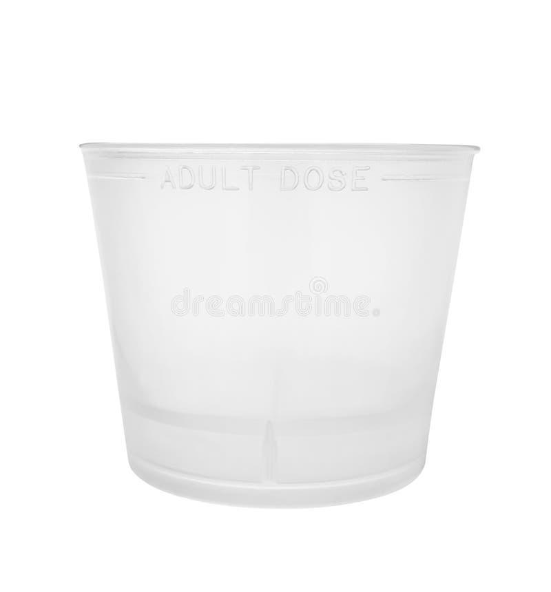 Медицина измеряя чашки стоковая фотография