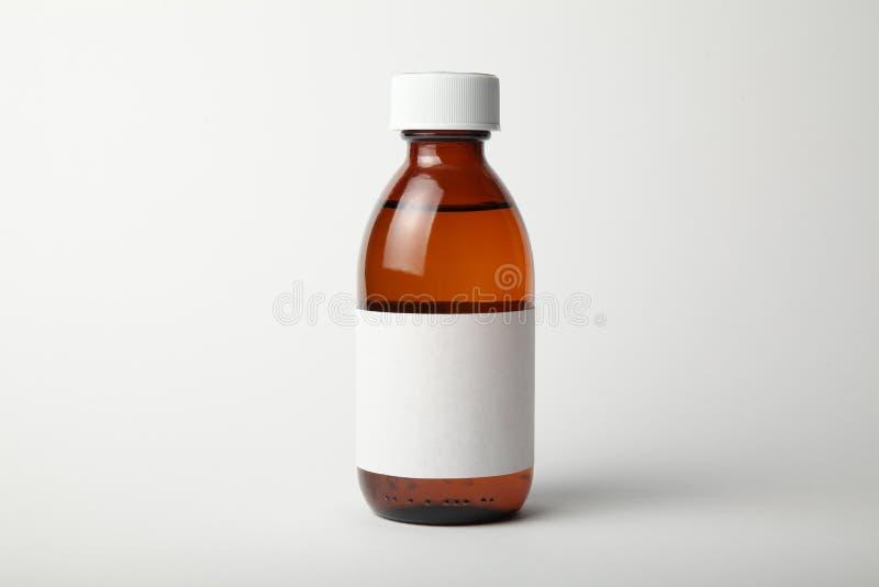 Медицинский модель-макет стеклянной бутылки Шаблон, пустой ярлык стоковые изображения
