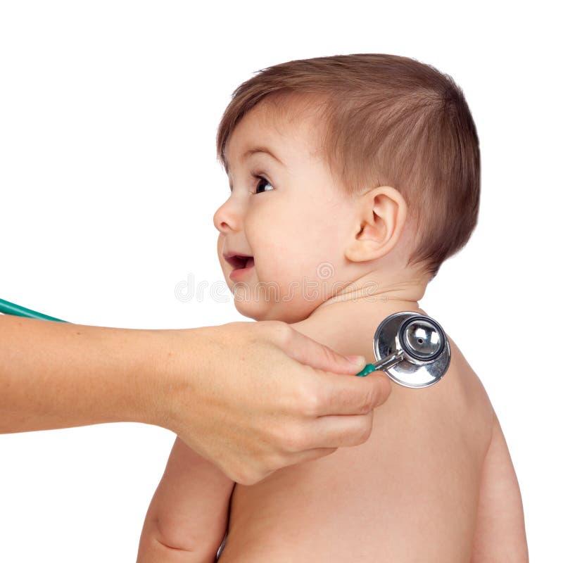 Медицинский осмотр к красивейшему младенцу стоковая фотография