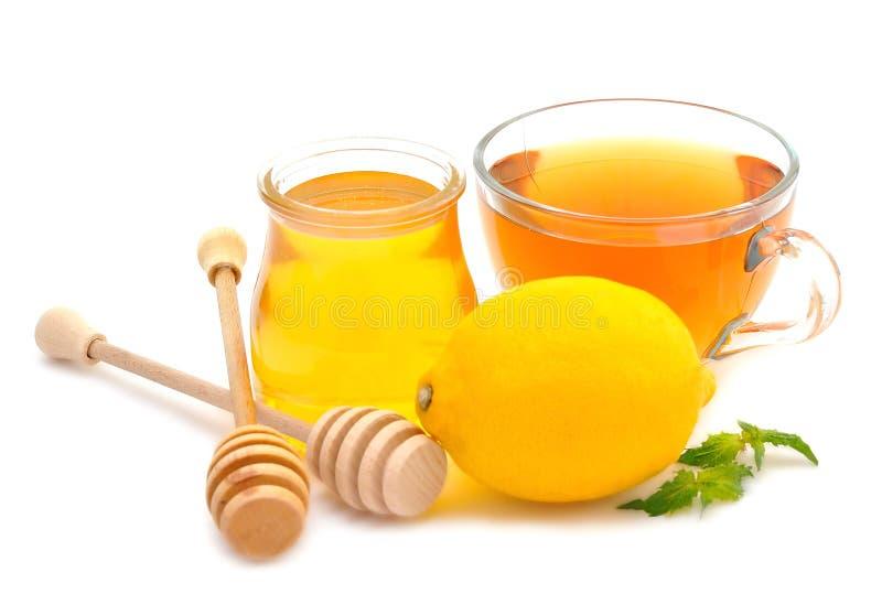 Мед, чай и лимон стоковые изображения rf