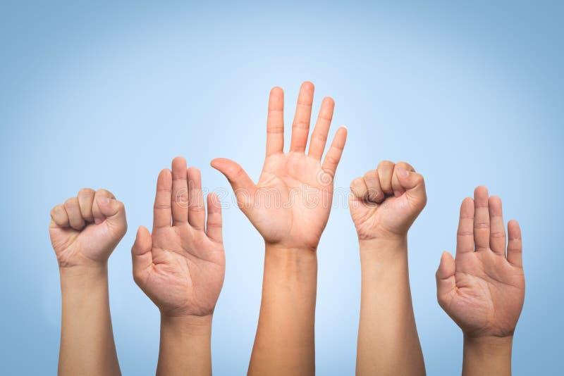 Международная концепция дня прав человека, рука повышения вверх стоковые изображения rf