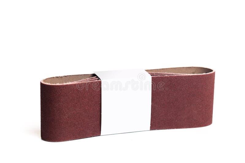 Меля бумага прокладки для шлифовального станка изолированного на белом фоновом изображении стоковая фотография rf