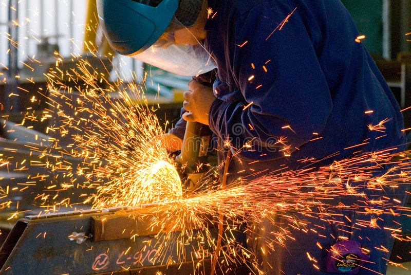 меля работа людей стальная стоковые фотографии rf