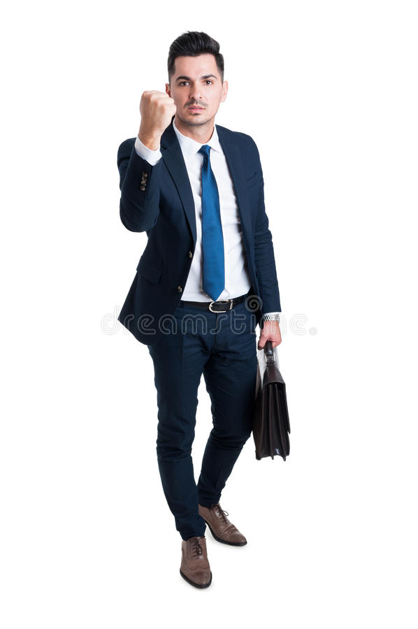 Менеджер предпринимателя или босса угрожая с его кулаком стоковые изображения