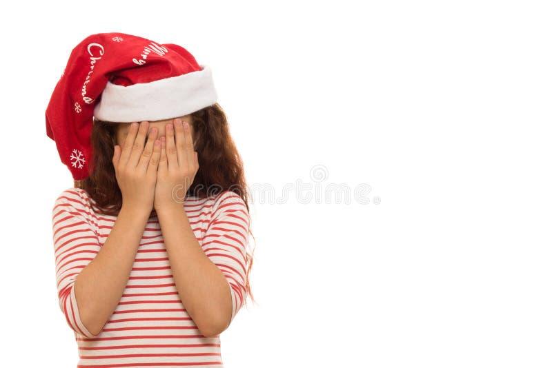 Меньшая девушка Санта в шляпе рождества стоковая фотография rf