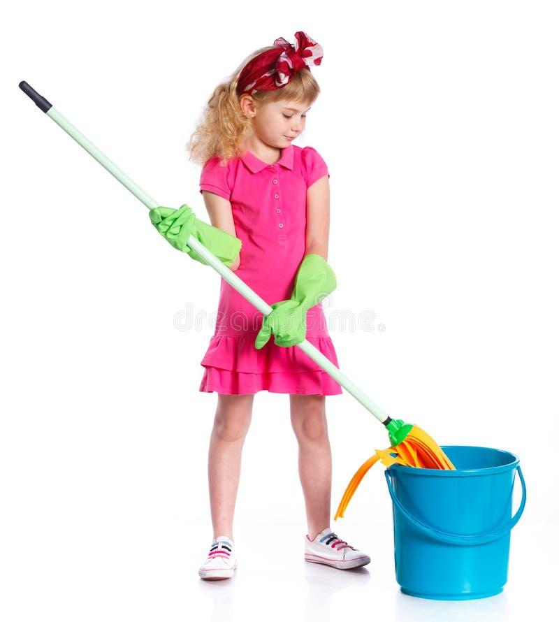 Меньшая девушка чистки стоковое изображение rf