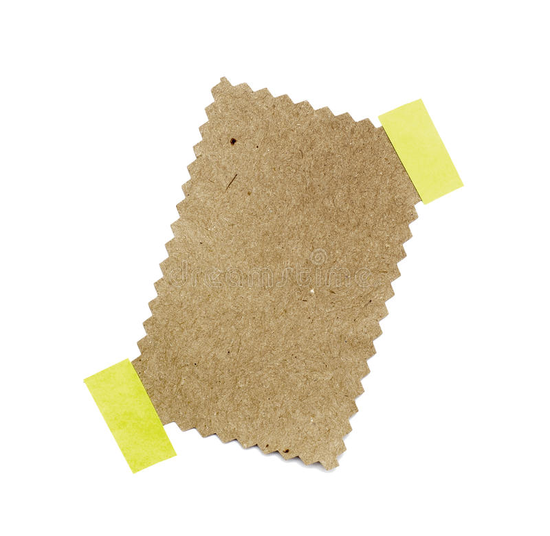 Меньший кусок бумаги, котор держит прилипатель стоковое изображение