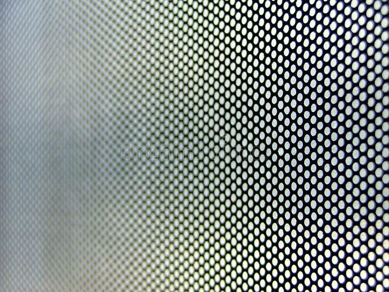 металлическая пефорированная поверхность стоковая фотография
