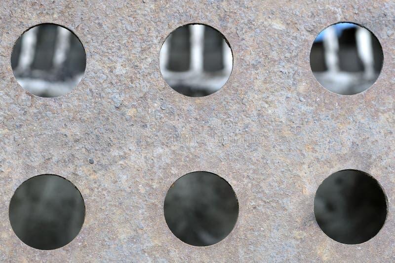 металлические текстура и отверстия в ей стоковое изображение