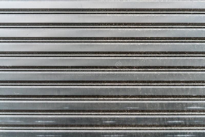 Металлический лист строба ролика стоковые фото