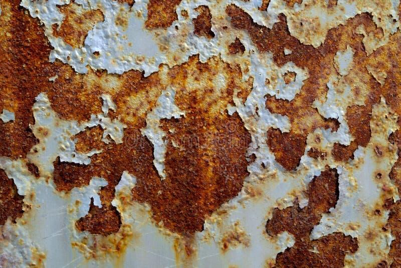 Металл текстуры ржавчины вычислил по маcштабу предпосылку grunge краски грубую стоковое фото