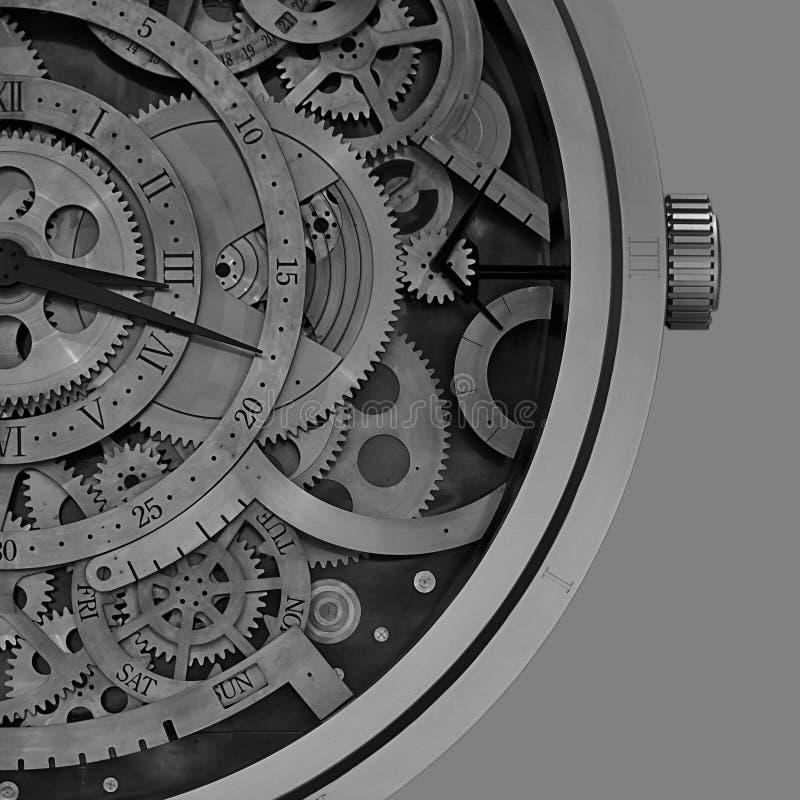 Механически детали часов с геометрическими картинами внутрь стоковая фотография
