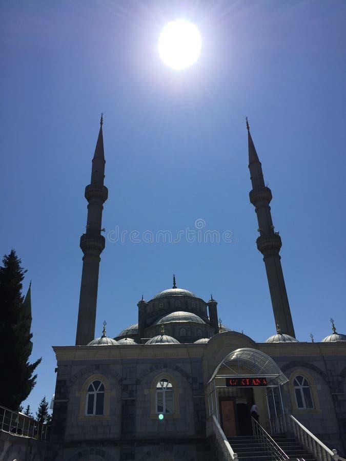 Мечеть и солнце стоковое изображение