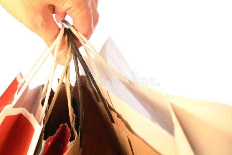 мешки держа изолированную покупку стоковое фото