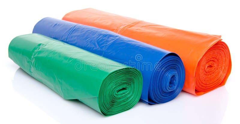 Мешки для мусора в голубом, апельсине и зеленом цвете стоковая фотография rf