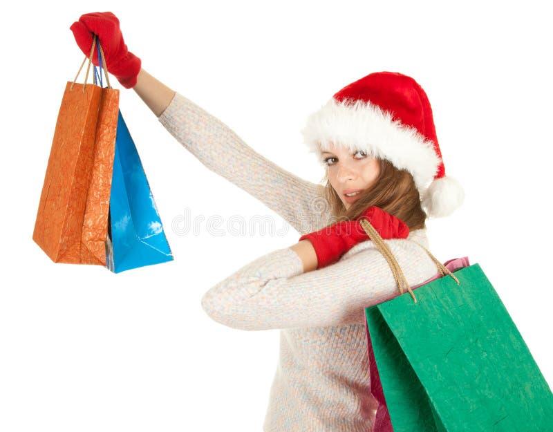 мешок нося одетьнную покупку santa шлема девушки стоковое фото