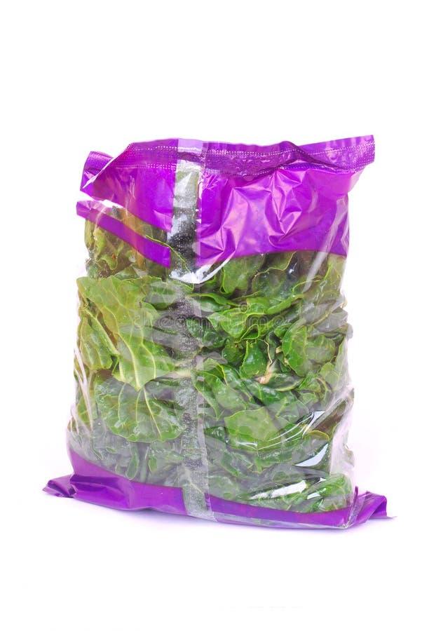 мешок shredded шпинат стоковое фото