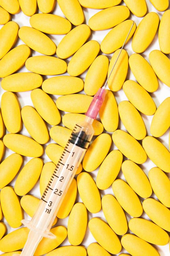 Медицинские-Syrige caplets капсул таблеток пилюлек стоковые изображения