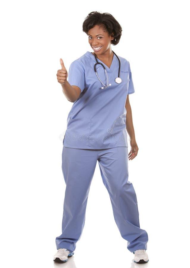 Медсестра давая большие пальцы руки вверх стоковое фото rf