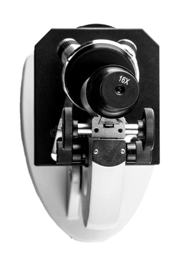 Микроскоп школы при объектив снятый выше стоковые изображения