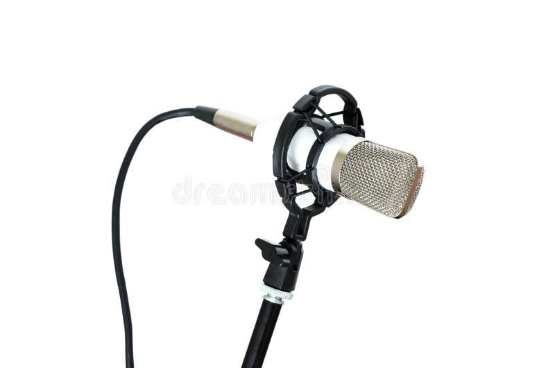 Микрофон установленный на шкаф на белой предпосылке стоковые фото
