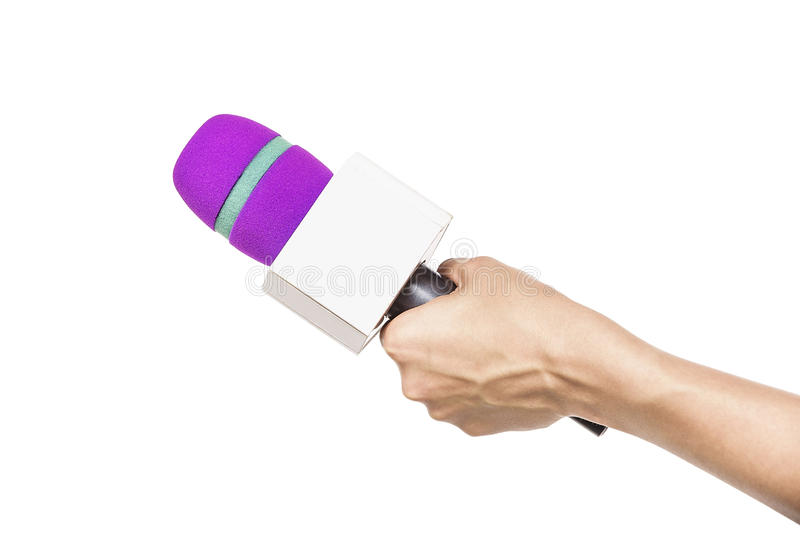 микрофон удерживания руки предпосылки близкий вверх по белизне стоковая фотография rf